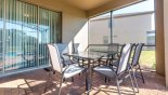 Patio table with 6 chairs - great for alfresco meals - www.iwantavilla.com is the best in Orlando vacation Villa rentals