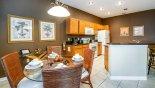 Breakfast nook viewed towards kitchen - www.iwantavilla.com is the best in Orlando vacation Villa rentals