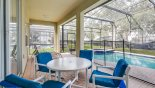 Villa rentals in Orlando, check out the View of pool & spa from covered lanai showing erected pool safety fence