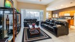 Villa rentals near Disney direct with owner, check out the Family room with comfortable leather sofas & views onto pool deck