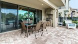 Patio table under covered lanai with 6 chairs - www.iwantavilla.com is the best in Orlando vacation Villa rentals