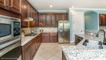 Fully fitted kitchen with quality appliances and granite counter tops - www.iwantavilla.com is the best in Orlando vacation Villa rentals