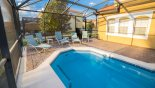 Pool has safety fence shown stowed away to side from Encantada rental Townhouse direct from owner