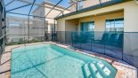 View towards covered lanai showing pool safety fence erected from Windsor at Westside rental Villa direct from owner