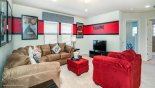 Entertainment loft with large LCD cable TV with this Orlando Villa for rent direct from owner