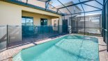 Lakeshore 3 Villa rental near Disney with View towards covered lanai showing pool safety fence erected
