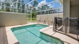 Pool deck showing pool safety fence erected from Beach Palm 15 Townhouse for rent in Orlando