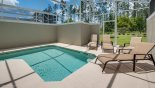Spacious rental Champions Gate Villa in Orlando complete with stunning Pool deck with 4 sun loungers and conservation views