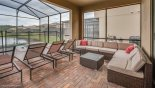 Rattan seating for 6 & 4 sun loungers under lanai from Hideaway 5 Villa for rent in Orlando