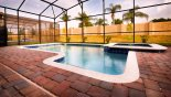 Pool & spa at sunset from Cayman 1 Villa for rent in Orlando