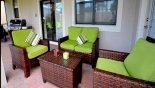 Covered lanai with comfortable rattan seating area, patio table with 6 chairs & gas BBQ - www.iwantavilla.com is your first choice of Villa rentals in Orlando direct with owner