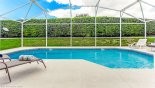 Sunny east facing pool deck with 28' heated pool with this Orlando Villa for rent direct from owner
