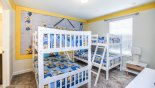 Bedroom #3 with dual twin bunk beds and Minions theming from Fiji 2 Villa for rent in Orlando