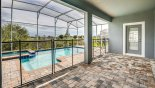Orlando Villa for rent direct from owner, check out the View of pool from covered lanai showing pool safety fence erected
