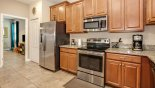 Spacious rental Champions Gate Villa in Orlando complete with stunning Fully fitted kitchen viewed towards bunk bedroom #7