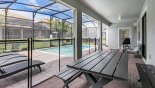 Villa rentals in Orlando, check out the Patio table with bench seating under shady lanai