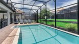Spacious rental Champions Gate Villa in Orlando complete with stunning Pool viewed towards sun loungers