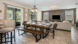 Villa rentals in Orlando, check out the Dining area viewed towards family room