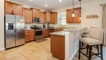 Kitchen with breakfast bar & 3 bar stools - www.iwantavilla.com is your first choice of Villa rentals in Orlando direct with owner