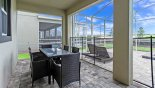 Covered lanai with patio table & 6 padded chairs with this Orlando Villa for rent direct from owner