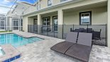 Villa rentals in Orlando, check out the Pool deck with 4 sun loungers (2 behind safety fence)