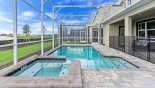 View of pool deck showing pool safety fence erected - www.iwantavilla.com is your first choice of Villa rentals in Orlando direct with owner