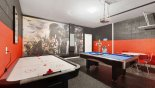 Spacious rental Solterra Resort Villa in Orlando complete with stunning Star Wars themed games room with pool table, air hockey & round table with 4 chairs