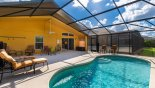 Villa rentals near Disney direct with owner, check out the Covered lanai showing patio table & 4 chairs + 4 reclining chairs, 2 footstools & 2 swivel armchairs