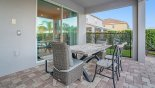 Spacious rental Reunion Resort Villa in Orlando complete with stunning Patio table with seating for 6 - 8 under shady lanai
