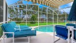 Villa rentals in Orlando, check out the View from under awning of pool & conservation woodland beyond