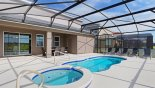 Villa rentals in Orlando, check out the Pool & spa viewed towards covered lanai
