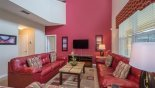 Villa rentals in Orlando, check out the Family room with large wall mounted LCD cable TV