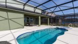 Covered lanai with patio table & 6 chairs with this Orlando Villa for rent direct from owner