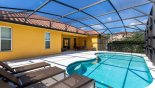 View of pool towards covered lanai with this Orlando Villa for rent direct from owner