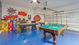 Superhero themed games room with air hockey, table tennis, table foosball & pool table - www.iwantavilla.com is the best in Orlando vacation Villa rentals