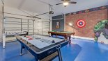 Spacious rental Champions Gate Villa in Orlando complete with stunning Superhero themed games room with air hockey, table tennis, table foosball & pool table