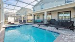 Spacious rental Champions Gate Villa in Orlando complete with stunning Pool deck with 4 sun loungers and shady day bed