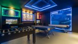 Villa rentals in Orlando, check out the Awesome games room with pool table, air hockey, table foosball & dual LED screens with PS4 and AC