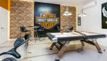 Villa rentals in Orlando, check out the Games room with air hockey, table foosball, dual LED screens, PS4 & 4 gaming chairs