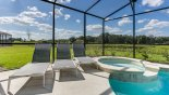 San Clemente 1 Villa rental near Disney with Pool deck with 3 sun loungers - small pond beyond the pool deck