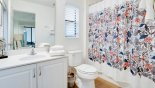 Villa rentals near Disney direct with owner, check out the Master #1 ensuite with bath & shower over, single vanity & WC - also serves as pool bath
