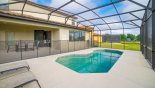 Villa rentals in Orlando, check out the View of pool to covered lanai - note pool safety fence erected