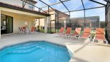 Spacious rental Providence Villa in Orlando complete with stunning View of idyllic pool through to alfresco dining area on the covered lanai
