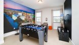 Spacious rental Reunion Resort Villa in Orlando complete with stunning Entertainment loft with table foosball game