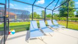 View of the deck with 4 relaxing  sun loungers - perfect to soak up the  Florida sun with this Orlando Villa for rent direct from owner
