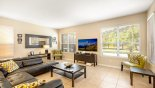 Family room with views onto pool deck from Watersong Resort rental Villa direct from owner