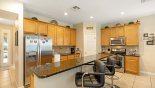 View of kitchen with breakfast bar & 3 bar stools - www.iwantavilla.com is your first choice of Villa rentals in Orlando direct with owner