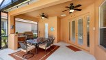 Spacious rental Watersong Resort Villa in Orlando complete with stunning Covered lanai with patio table & 6 chairs