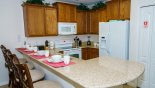 Bimini 5 Villa rental near Disney with Fully fitted kitchen with quality appliances and Corian countertops & 4 bar stools a breakfast bar
