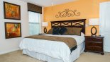 Villa rentals near Disney direct with owner, check out the Master bedroom #2 with king sized bed & views onto pool deck